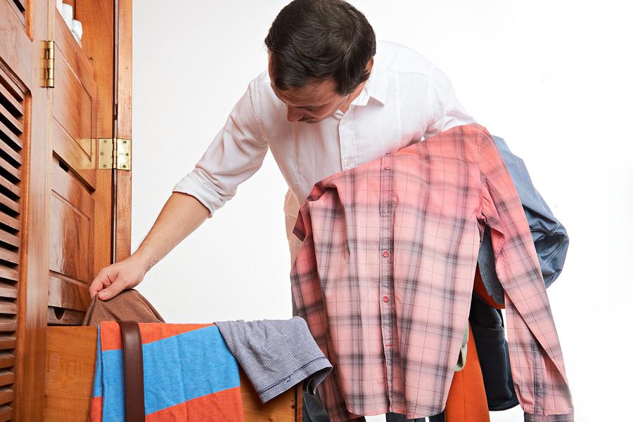 bigstock Man Choosing Cloth 151847612