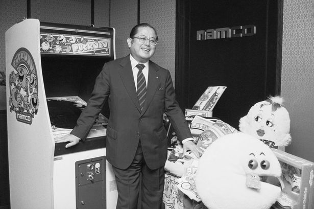 Video Game Designer Masaya Nakamura Posing with His Creations