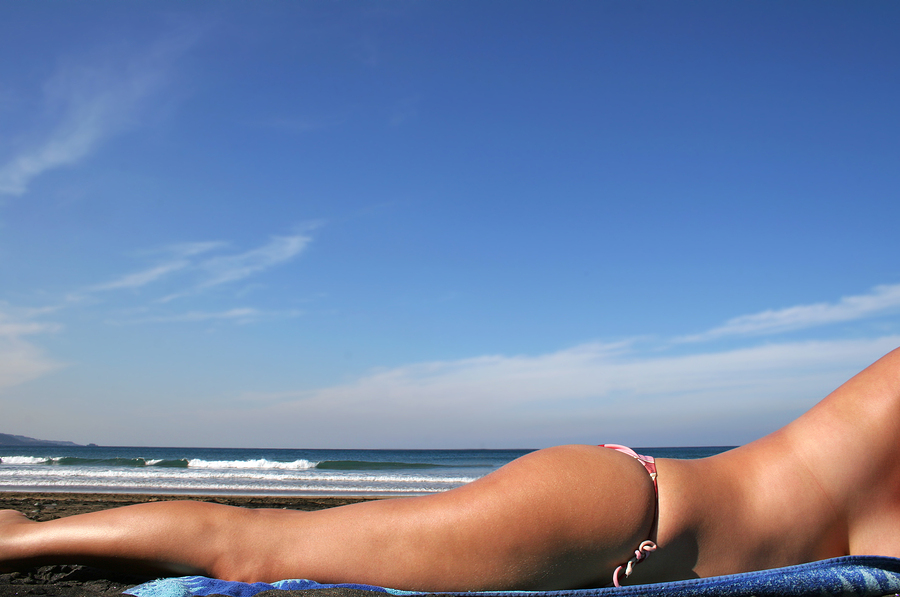 bigstock Sunbathing Bikini Girl 302124