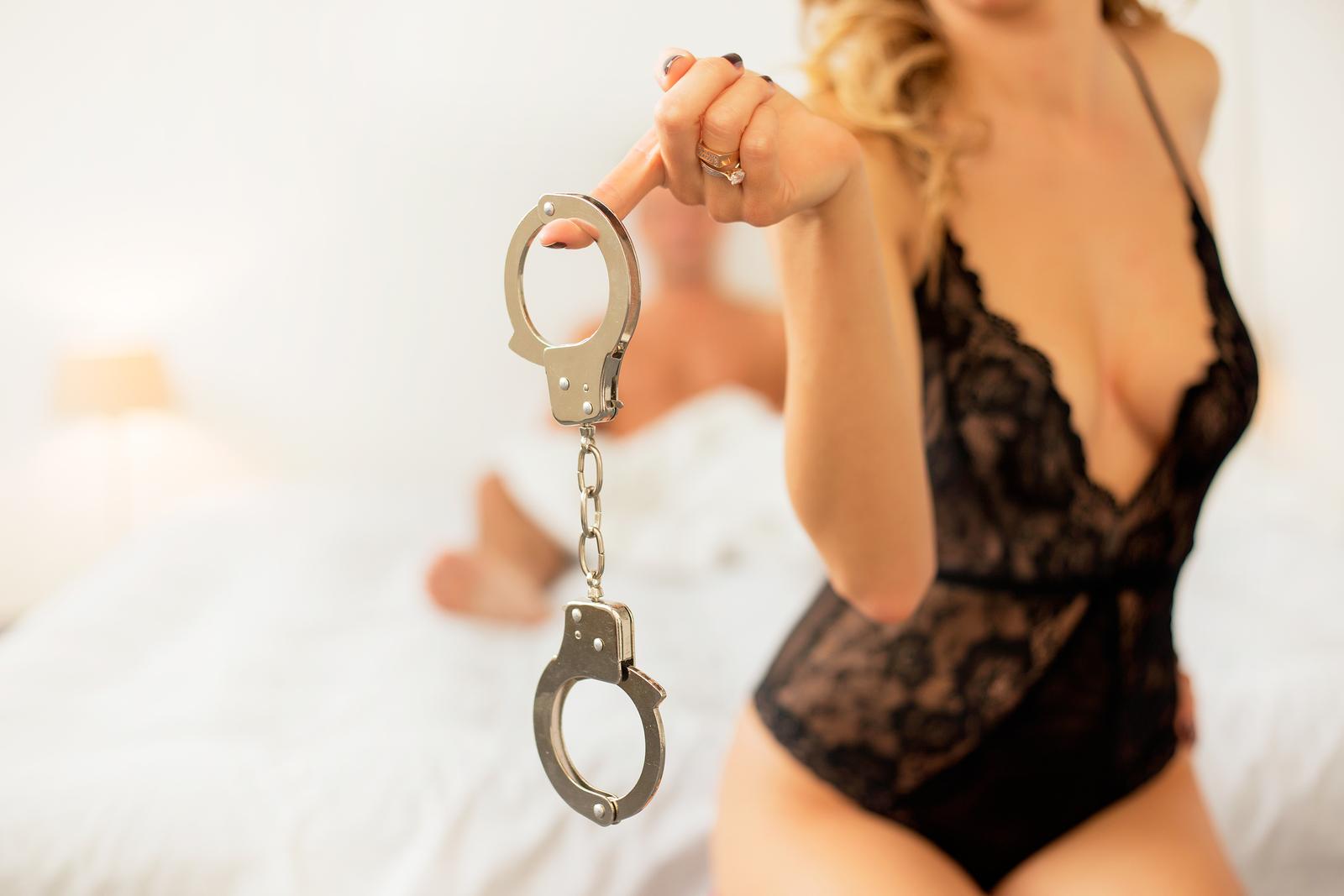 bigstock Woman holding handcuffs 109448591