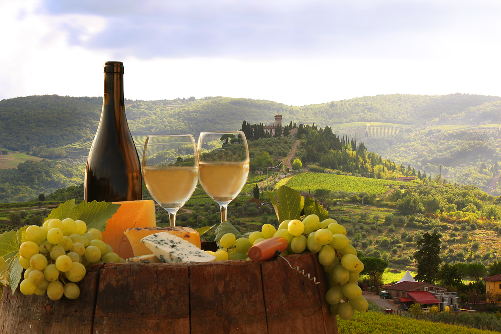 White wine with barrel on vineyard in Chianti Tuscany Italy 154393475