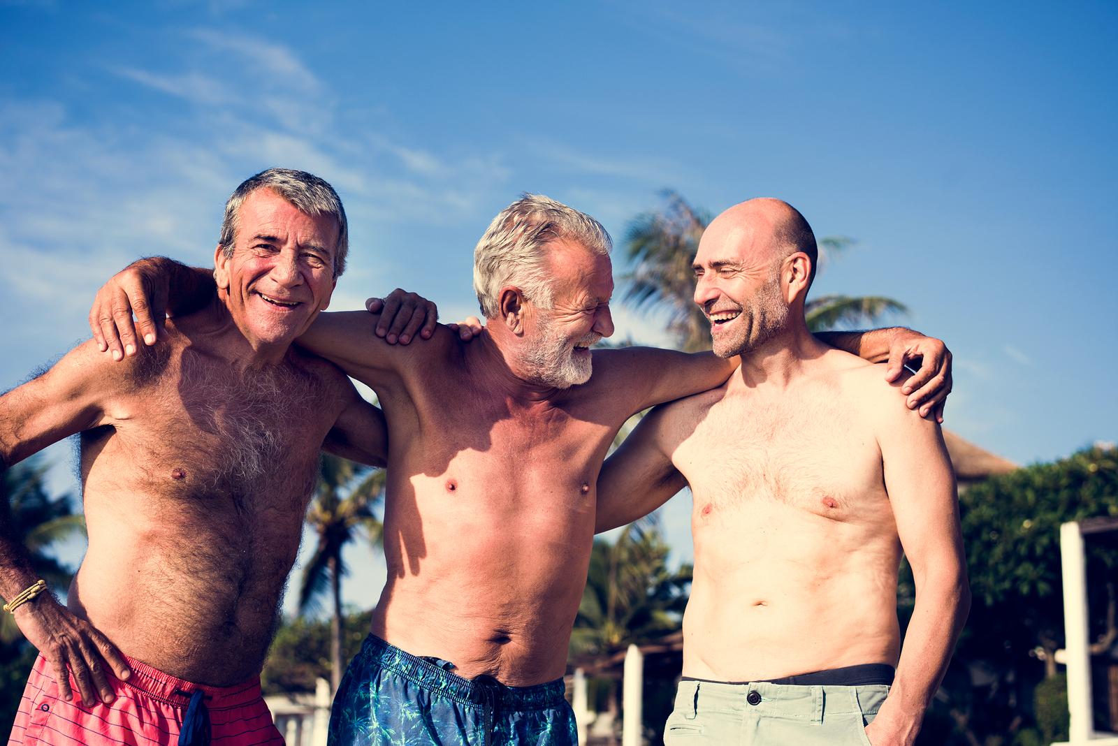 bigstock Group of senior men on the bea 244808368