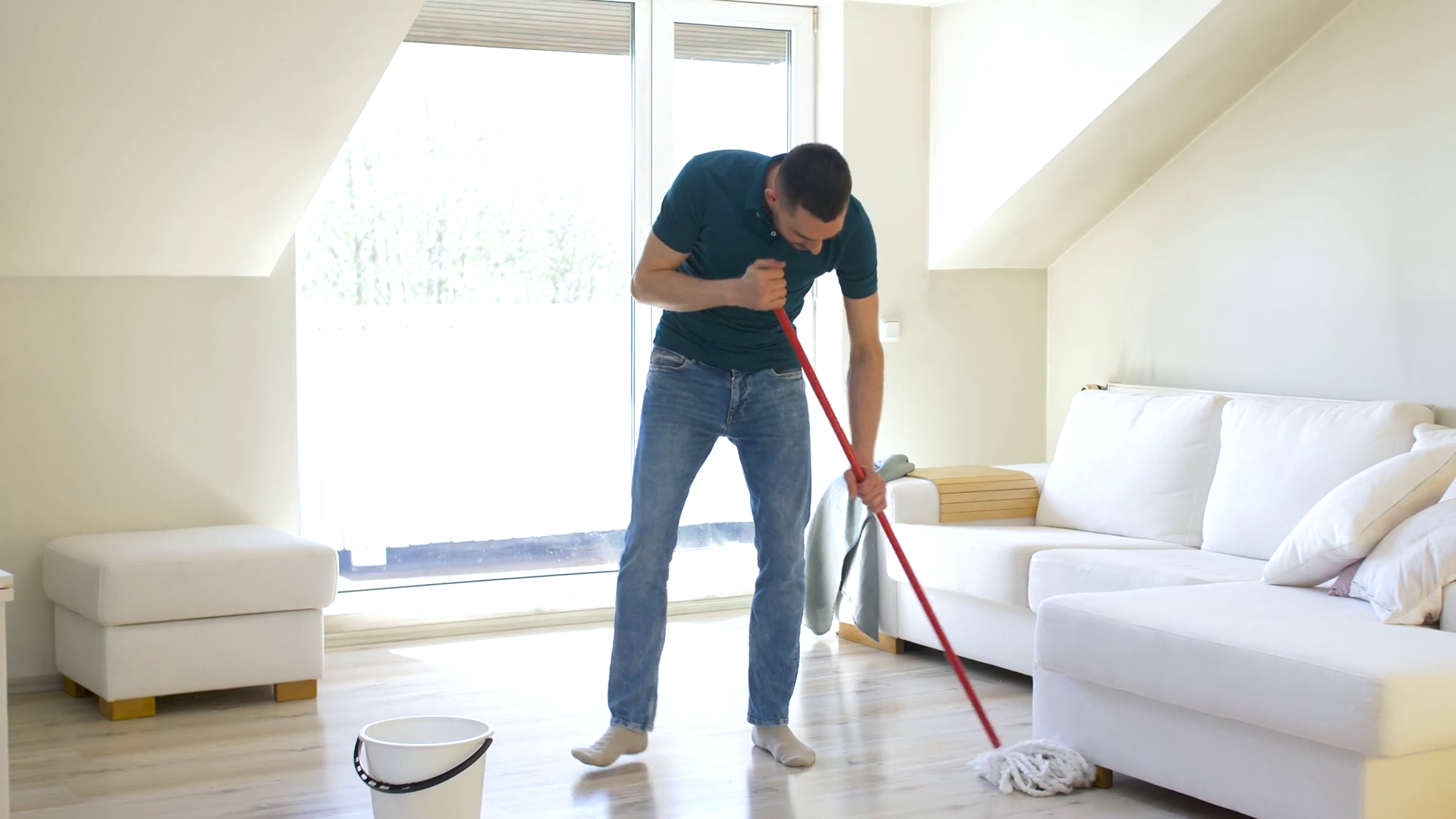 videoblocks people housework and housekeeping concept happy man with mop cleaning floor and dancing at home bygi5zccf thumbnail full01